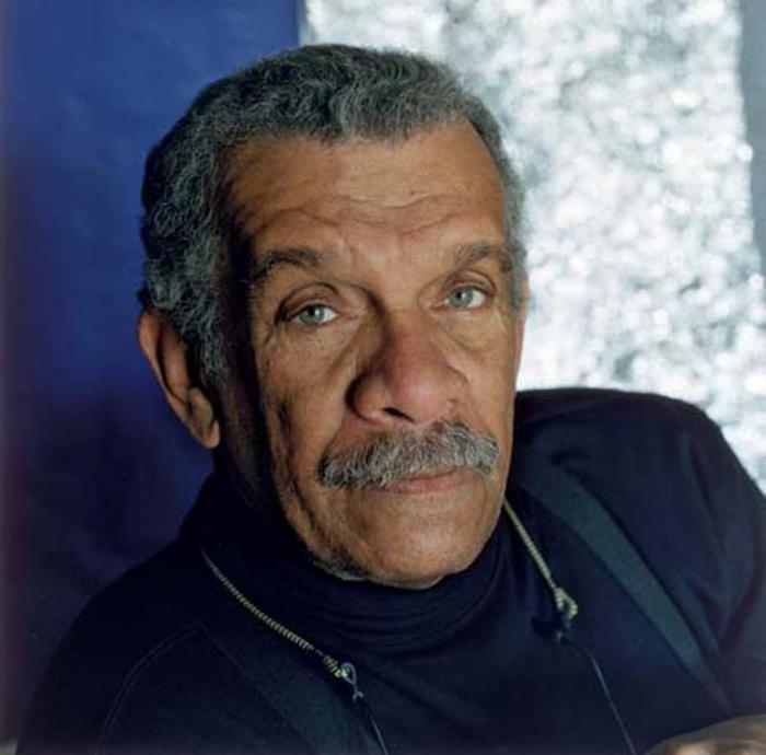 2000:  Studio headshot portrait of St. Lucian-born poet and dramatist Derek Walcott wearing a black jacket and a black turtleneck. Walcott won the Nobel Prize in 1992.  (Photo by Horst Tappe/Hulton Archive/)