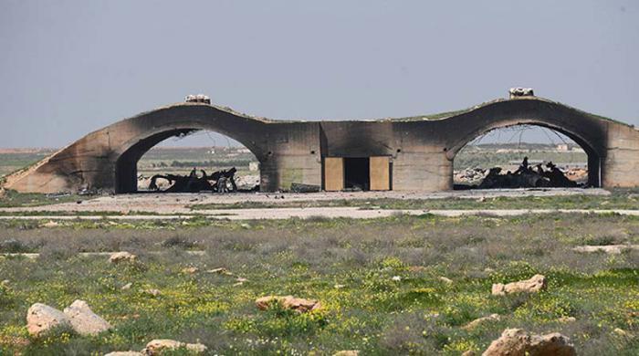 Aviones destruidos de la fuerza aérea siria en la base de Shayrat.