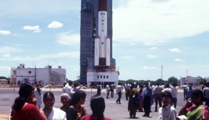 Indian women stand outside the PSLV Space Center to watch a satellite rocket launch. --- Photo by Pallava Bagla/Corbis Sygma (Photo by Pallava Bagla/Corbis via Getty Images)